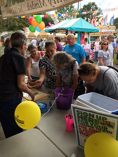 Fair goers signing up at Crawford County Bank booth