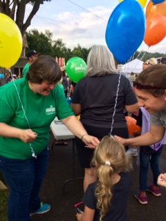 Stoneboro Fair Bank Night Giving out balloons